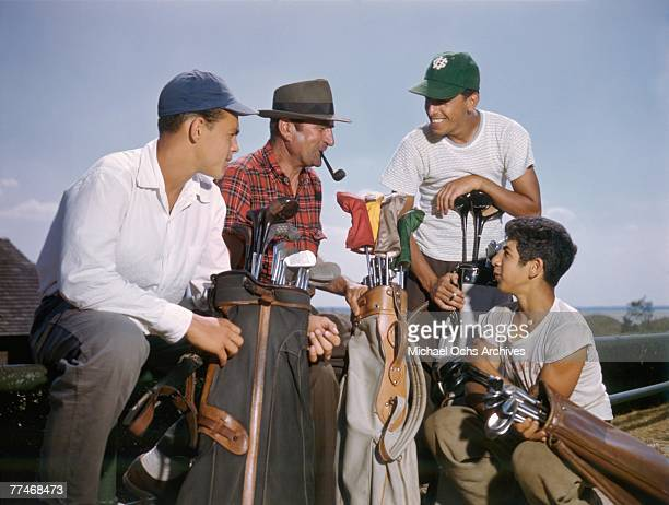 Golf caddies chat before setting out on the course at the National Golf Links of America Southampton New York in 1950 This photo was shot for the...