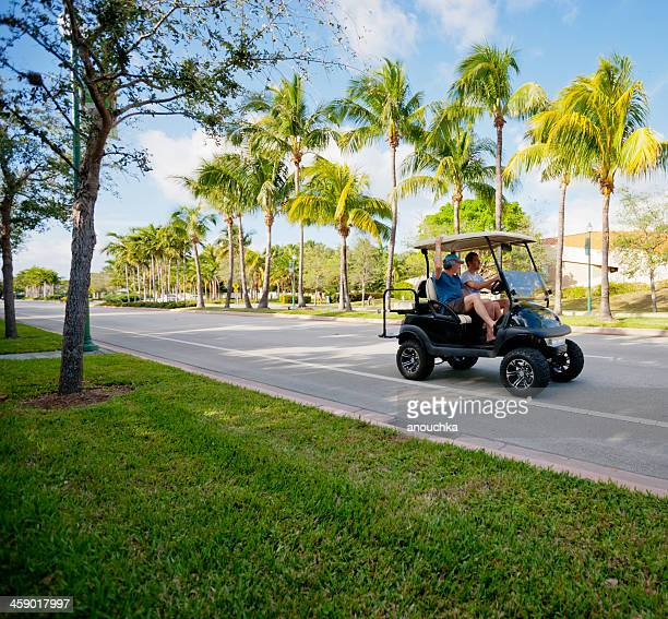 golf car on key biscayne street, florida, usa - key biscayne stock pictures, royalty-free photos & images