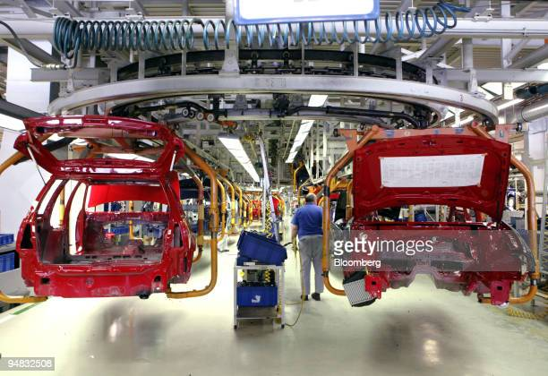 Golf cars are seen on the production line at the Volkswagen factory in Wolfsburg, Germany, Thursday, March 2, 2006.