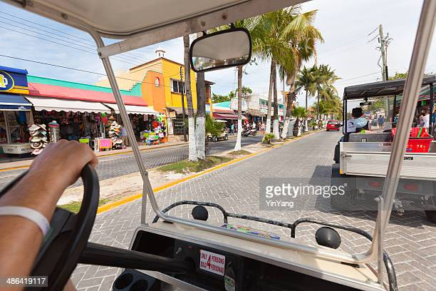 golf cart on street of isla mujeres of cancun mexico - quintana roo stock photos and pictures