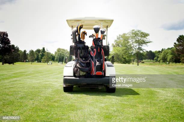 Golf cart parked on golf course