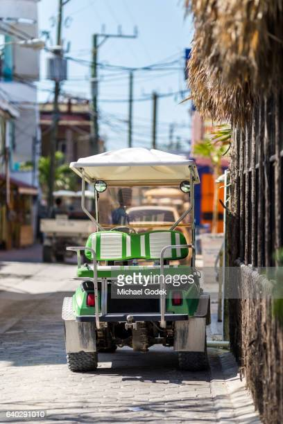 Golf cart parked outside a storefront in Sand Pedro Belize