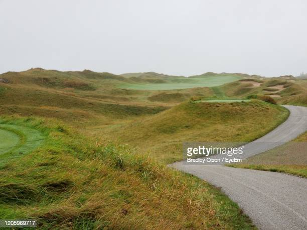 golf cart path along links style hole on misty day - wisconsin stock pictures, royalty-free photos & images