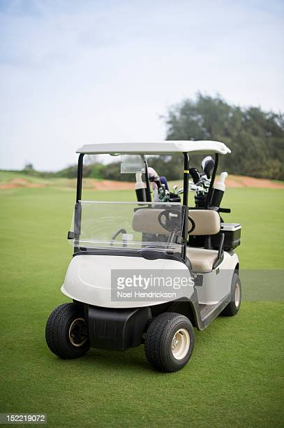 A golf cart sits on the golf course