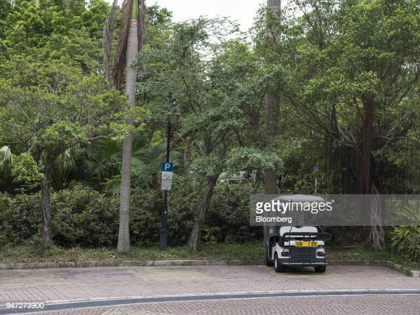 A golf cart stands at a parking lot in Discovery Bay a residential project developed by Hong Kong Resort Co on Lantau Island in Hong Kong China on...