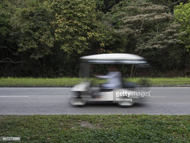 A golf cart travels along a road in Discovery Bay a residential project developed by Hong Kong Resort Co on Lantau Island in Hong Kong China on...
