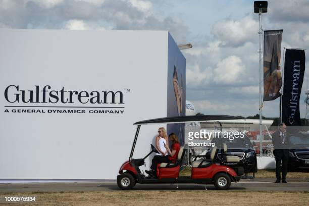 An attendee tries a flight simulator on day two of the Farnborough International Airshow 2018 in Farnborough UK on Tuesday July 17 2018 The air show...