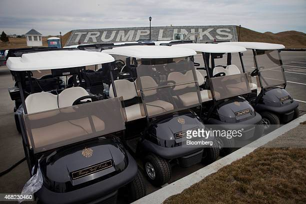 Golf carts prepared for opening day sit at the Trump Links golf course in the Bronx borough of New York, U.S., on Tuesday, March 31, 2015. The...