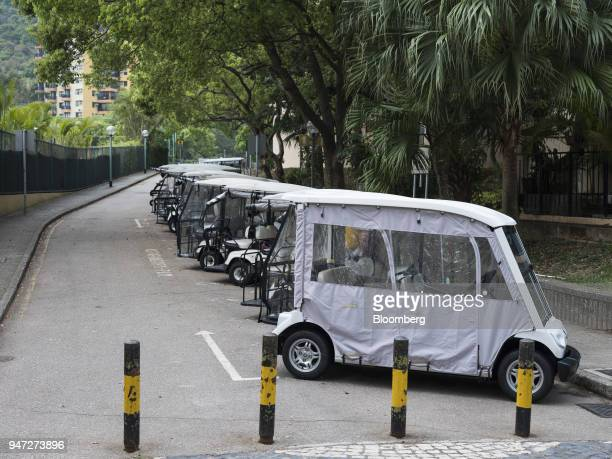 Golf carts stand parked in Discovery Bay a residential project developed by Hong Kong Resort Co on Lantau Island in Hong Kong China on Tuesday March...