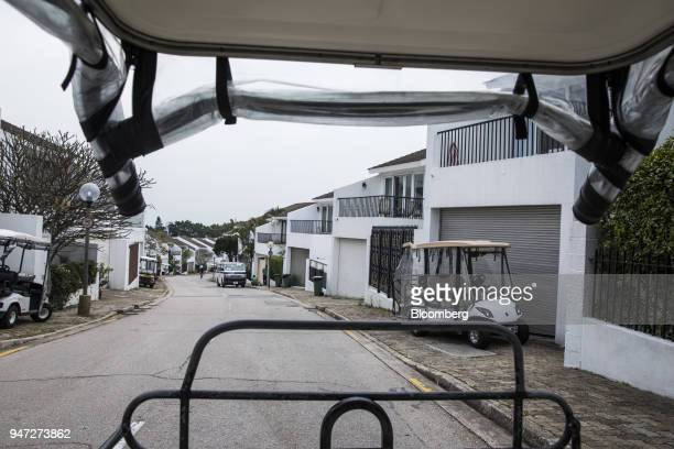 Golf carts stand parked in front of residential houses in Discovery Bay a residential project developed by Hong Kong Resort Co on Lantau Island in...