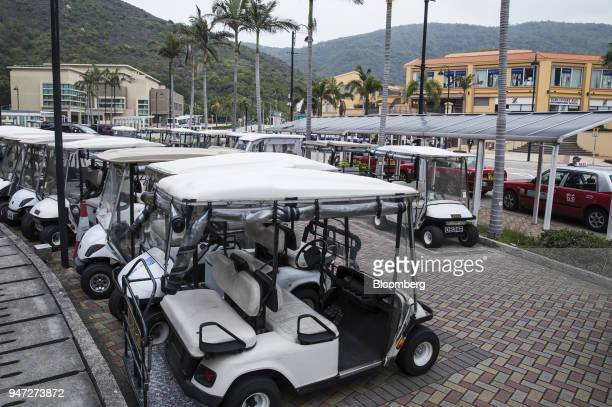 Golf carts stand parked next to a taxi stand in Discovery Bay a residential project developed by Hong Kong Resort Co on Lantau Island in Hong Kong...