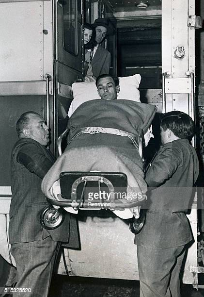 Golf champion Ben Hogan is lifted from a train which brought him to his home town to recuperate from a near fatal auto accident He was hospitalized...