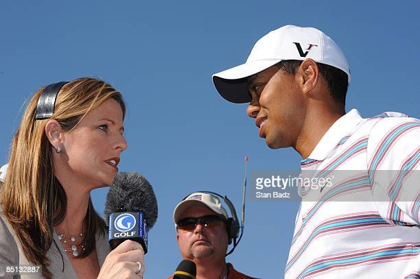 Golf Channel coanchor Kelly Tilghman left interviews Tiger Woods right after his defeat to Tim Clark during the second round of the World Golf...