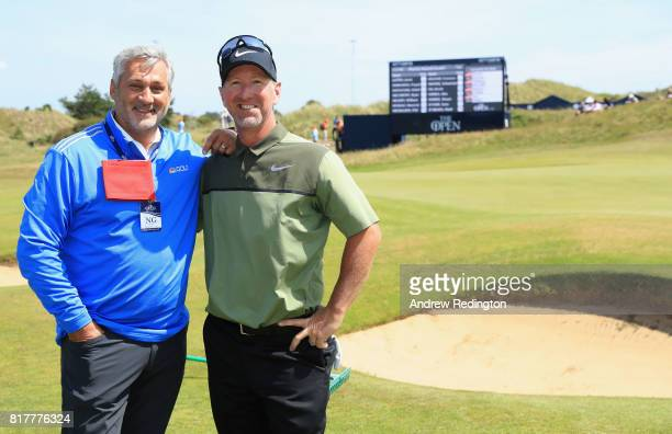 Golf Channel commentator Frank Nobilo of New Zealand with David Duval of the United States during a practice round prior to the 146th Open...
