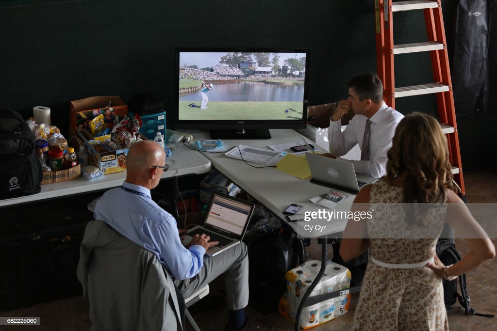 Golf Channel staff watch coverage from the NBC/Golf Channel LIVE