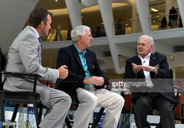 Golf Channel's Todd Lewis along with Hale Irwin and David Graham at the Fan Experience at Oculus prior to the start of the Presidents Cup at Liberty...