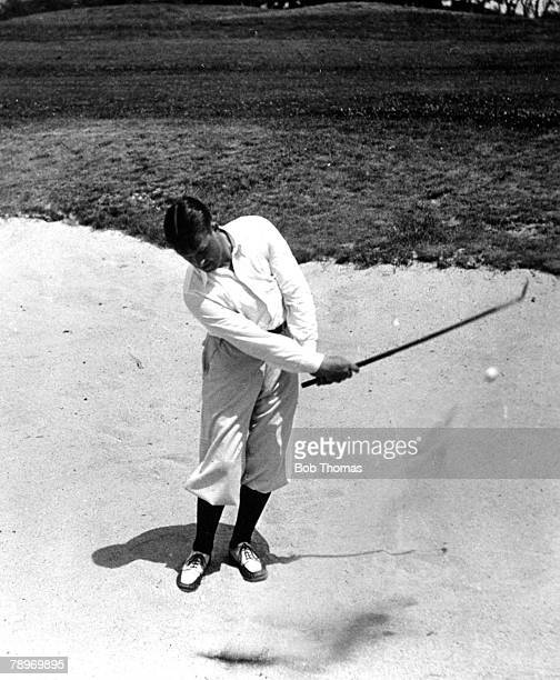 Golf Circa 1930 Winged Foot Country Club Mamaroneck New York USA's Bobby Joneswinner of 3 British and 4 USOpens playing out of the sand trap to the...