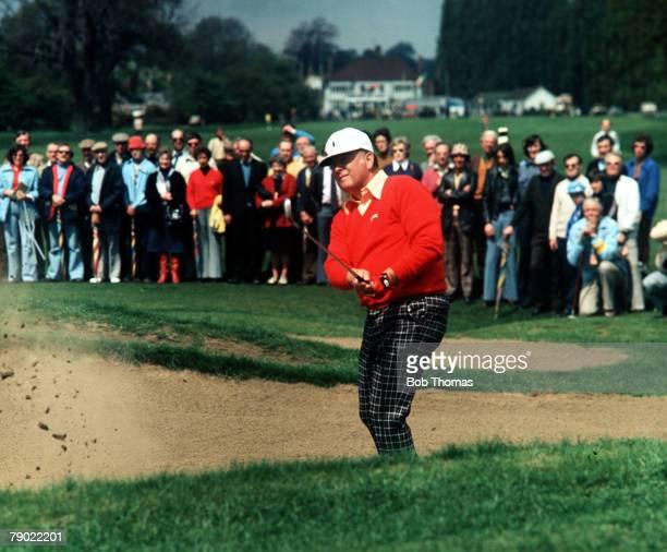 Golf Circa 1970's USA's Billy Casper blasts out of a sand trap