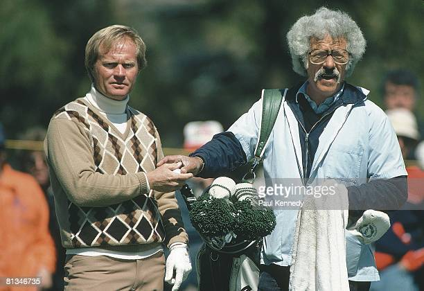 Golf Closeup of Jack Nicklaus with caddie Angelo Argea during practice 3/22/1981