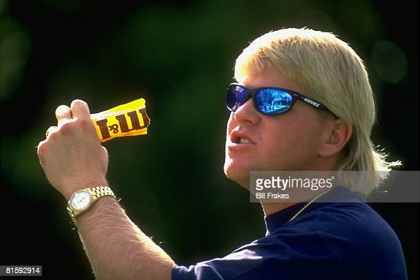 Golf Closeup portrait of John Daly wearing sunglasses and eating MM Peanuts candy Orlando FL 5/13/1993