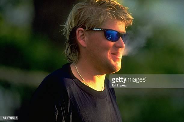 Golf Closeup portrait of John Daly wearing sunglasses and smoking cigarette Orlando FL 5/13/1993