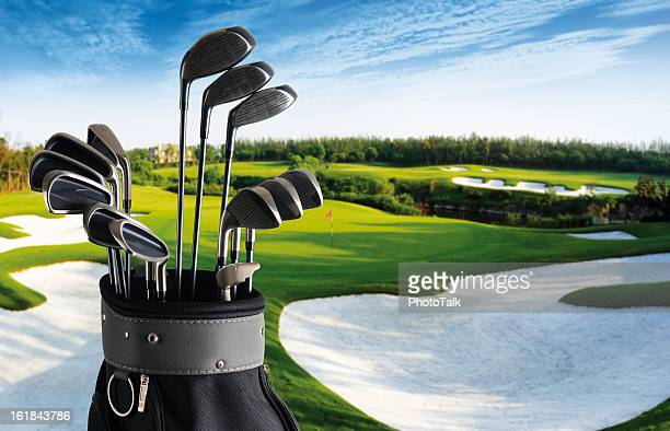 golf club and bag with fairway background - xxlarge - drive ball sports stock pictures, royalty-free photos & images