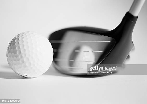 Golf club and ball, close-up, b&w.