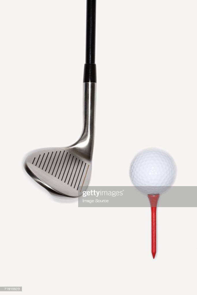 Golf club with golf ball on a tee : Stock Photo
