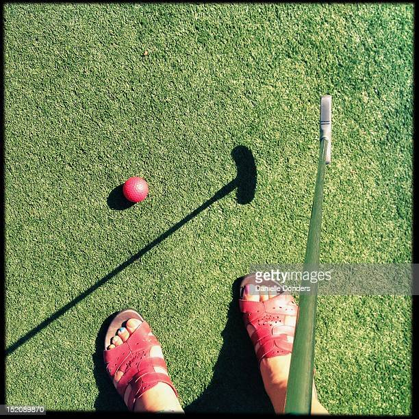 Golf club with red ball