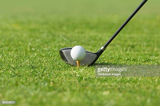 Golf club with tee and golf ball