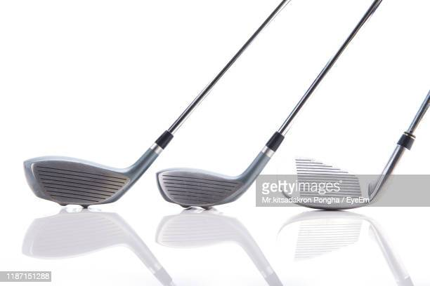 golf clubs against white background - ゴルフクラブ ストックフォトと画像