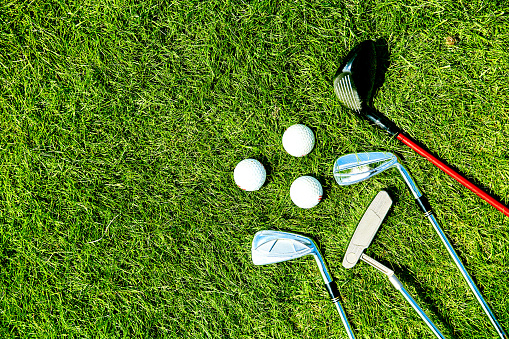 golf clubs and balls on grass 1064630790