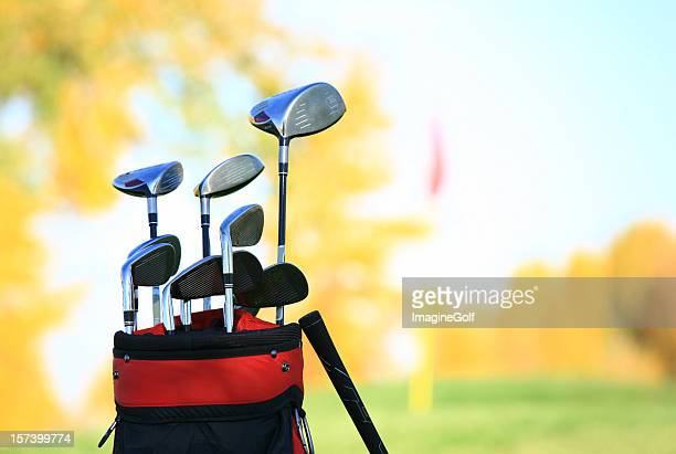 golf clubs and equipment at a beautiful fall course - golfclub stockfoto's en -beelden