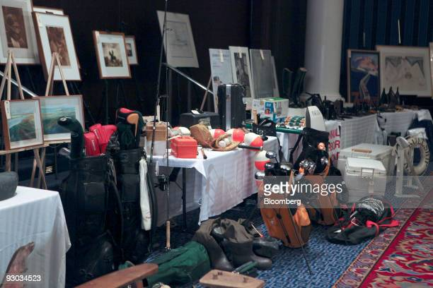 Golf clubs and framed photos are amoung lots displayed during a media preview for an auction which includes jewelry and other personal items...