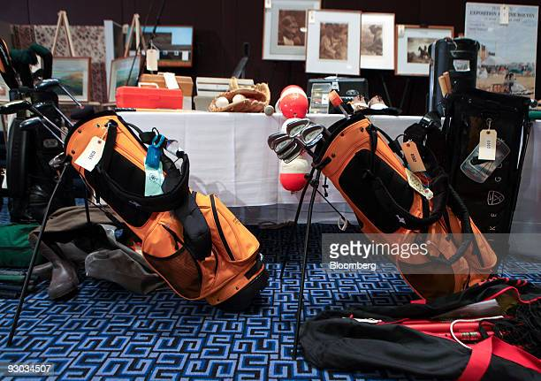 Golf clubs and framed photos are amoung lotts displayed during a media preview for an auction which includes jewelry and other personal items...