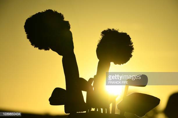Golf clubs are seen against the sun during a practice session ahead of the 42nd Ryder Cup at Le Golf National Course at SaintQuentinenYvelines...