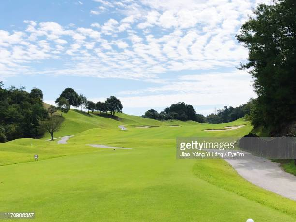 golf course against sky - golf course stock pictures, royalty-free photos & images