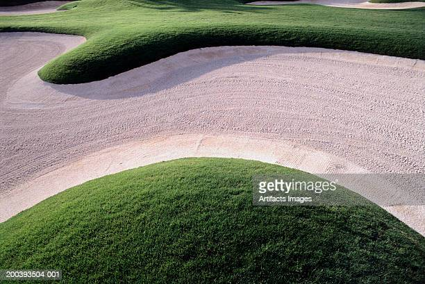 golf course and sand trap - sand trap stock pictures, royalty-free photos & images