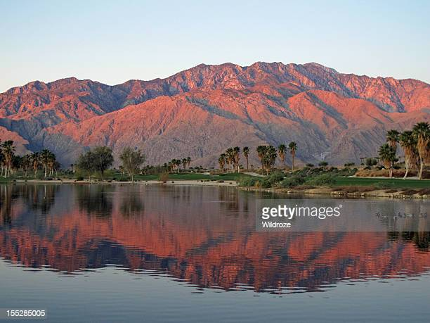golf course at dawn with sunrise kissed mountains - california stockfoto's en -beelden