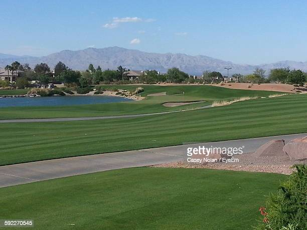 golf course by mountains against sky - casey nolan stock pictures, royalty-free photos & images