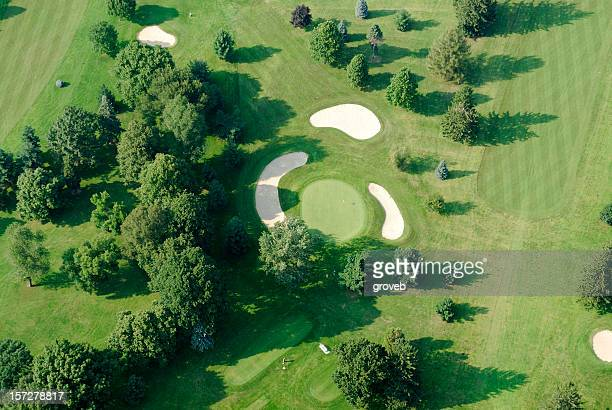 Golf course close up from the air.