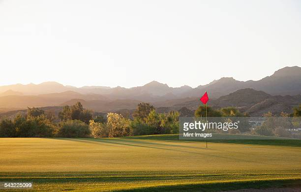 a golf course in arizona, and a view to mountains.  - golf flag stock pictures, royalty-free photos & images