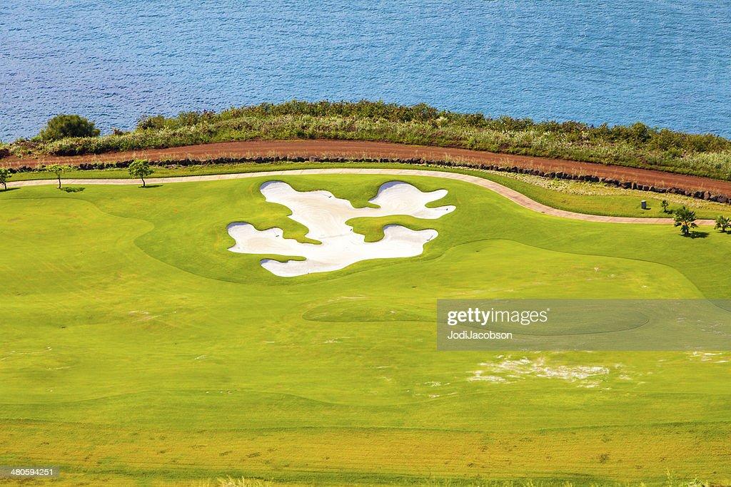 Golf course overlooking the Pacific Ocean in Kauai, Hawaii : Stock Photo
