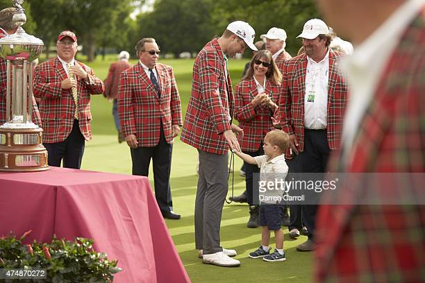 Crowne Plaza Invitational: Chris Kirk victorious in winner's jacket with his son Sawyer during trophy presentation ceremony after winning tournament...