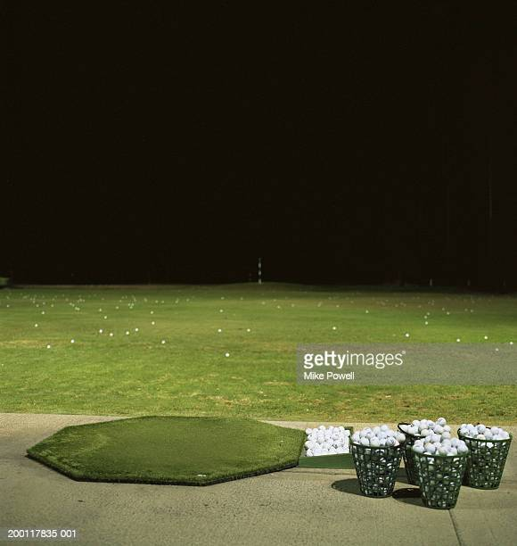 golf driving range at night - driving range stock photos and pictures