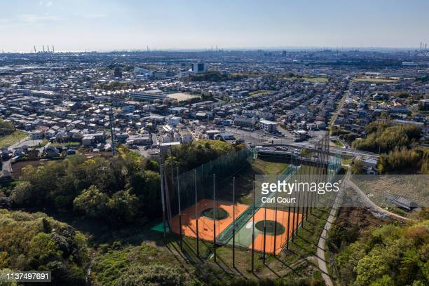 Golf driving range lies on the edge of a residential area, on April 16, 2019 in Ichihara, Japan.