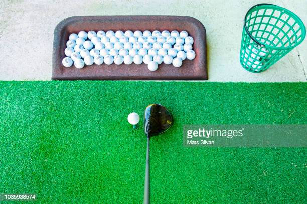 golf driving range with driver golf club - driving range stock pictures, royalty-free photos & images