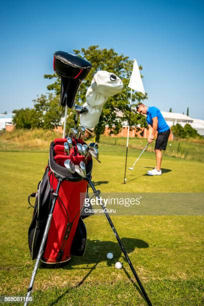 Golf Equipment with Golfer in the Back