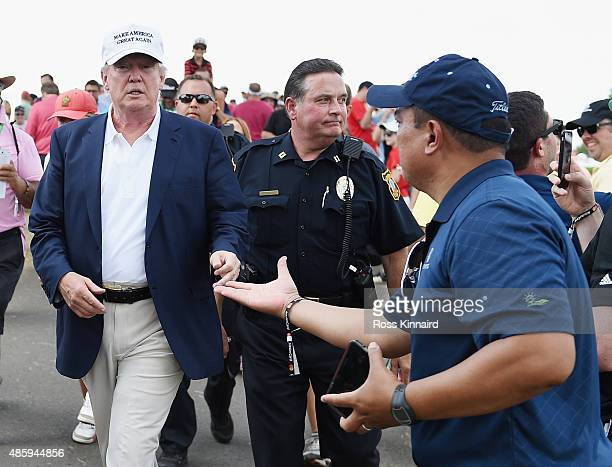 A golf fan greets presidential candidate Donald Trump during the final round of The Barclays at Plainfield Country Club on August 30 2015 in Edison...