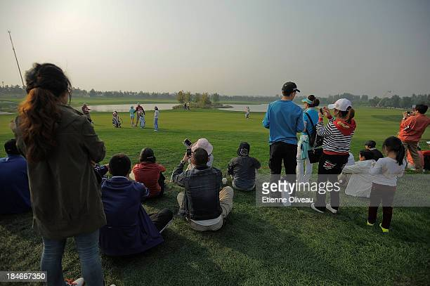 Golf fan sits on the side of the 18th course during the first round of the Reignwood LPGA Classic at Pine Valley Golf Club on October 3 2013 in...